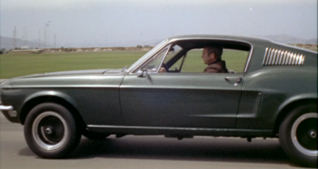 McQueen in Ford Mustang